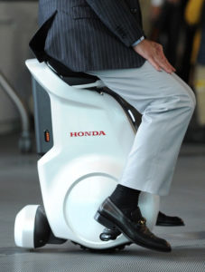 Former Japanese astronaut Mamoru Mori riding Honda UNICUB