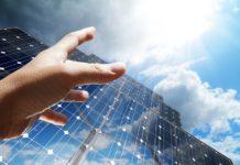 hand reaching for solar panels