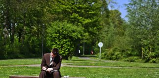 businessman sitting on park bench