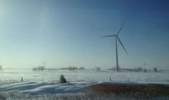 snowy wind turbines in Canada